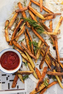 potato fries with rosemary laid out on paper