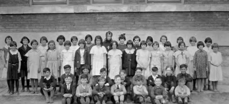 Black and white class photo of St. Albert Catholic School