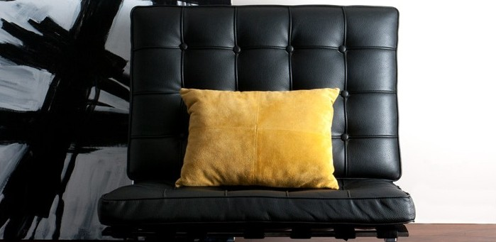 Black Chair with yellow pillow
