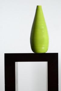 green vase on black table