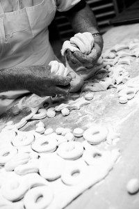 black and white photo of baker working with dough