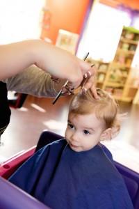 Little kid getting a hair cut