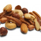 Variety of Mixed Nuts Isolated on White Background.
